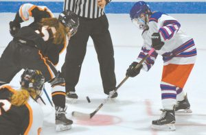 MT. ARARAT/MORSE'S Bre Hunter (left) faces off with Biddeford/Thornton Academy/Wells' Lily Stark (right) as Ella McKenzie looks on. The visiting Tigers won, 7-1.