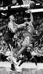 UTAH JAZZ center Rudy Gobert (27) tangles up with Houston Rockets guard James Harden (13) in the first half of an NBA basketball game on Sunday in Houston.