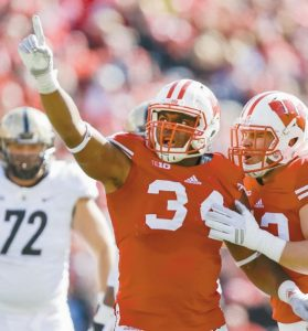 WISCONSIN'S Chikwe Obasih (34) celebrates after sacking the Purdue quarterback during the second half of an NCAA college football game in Madison, Wis. No. 8 Ohio State's improved offensive line will have a big challenge slowing down No. 3 Wisconsin's powerful defensive front. The Buckeyes' line has stabilized after an inconsistent season in 2016. They'll face a Badgers front in the Big Ten Championship that anchors the best defense in the nation. Wisconsin is limiting opponents to an average of just 236.9 yards per game.