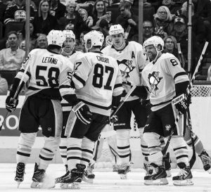 PITTSBURGH PENGUINS players celebrate a goal against the Edmonton Oilers during the second period of an NHL hockey game in Edmonton, Alberta, on Wednesday.