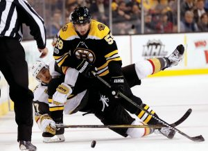 BOSTON'S Tim Schaller (59) battles Vegas Golden Knights' Luca Sbisa for the puck during the second period of an NHL hockey game in Boston on Thursday. The Bruins won, 2-1, and host the Washington Capitals on Saturday.
