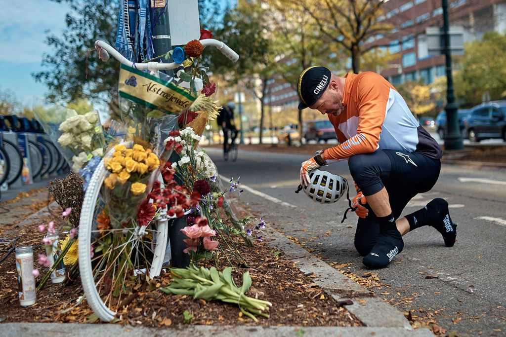 Eric Fleming, 41, expresses his condolences in front of a bike memorial where people leave flowers to remember the victims of Tuesday's attack, on Thursday in New York.
