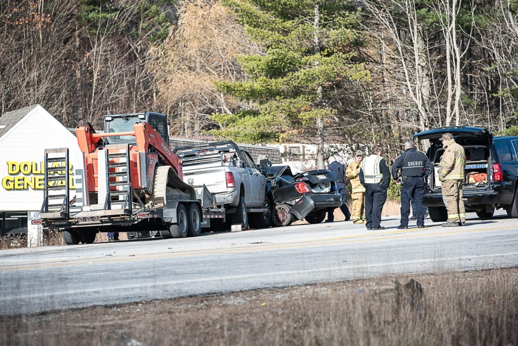 Emergency personnel and law enforcement gather at the scene of a fatal car accident in Turner on Wednesday morning.