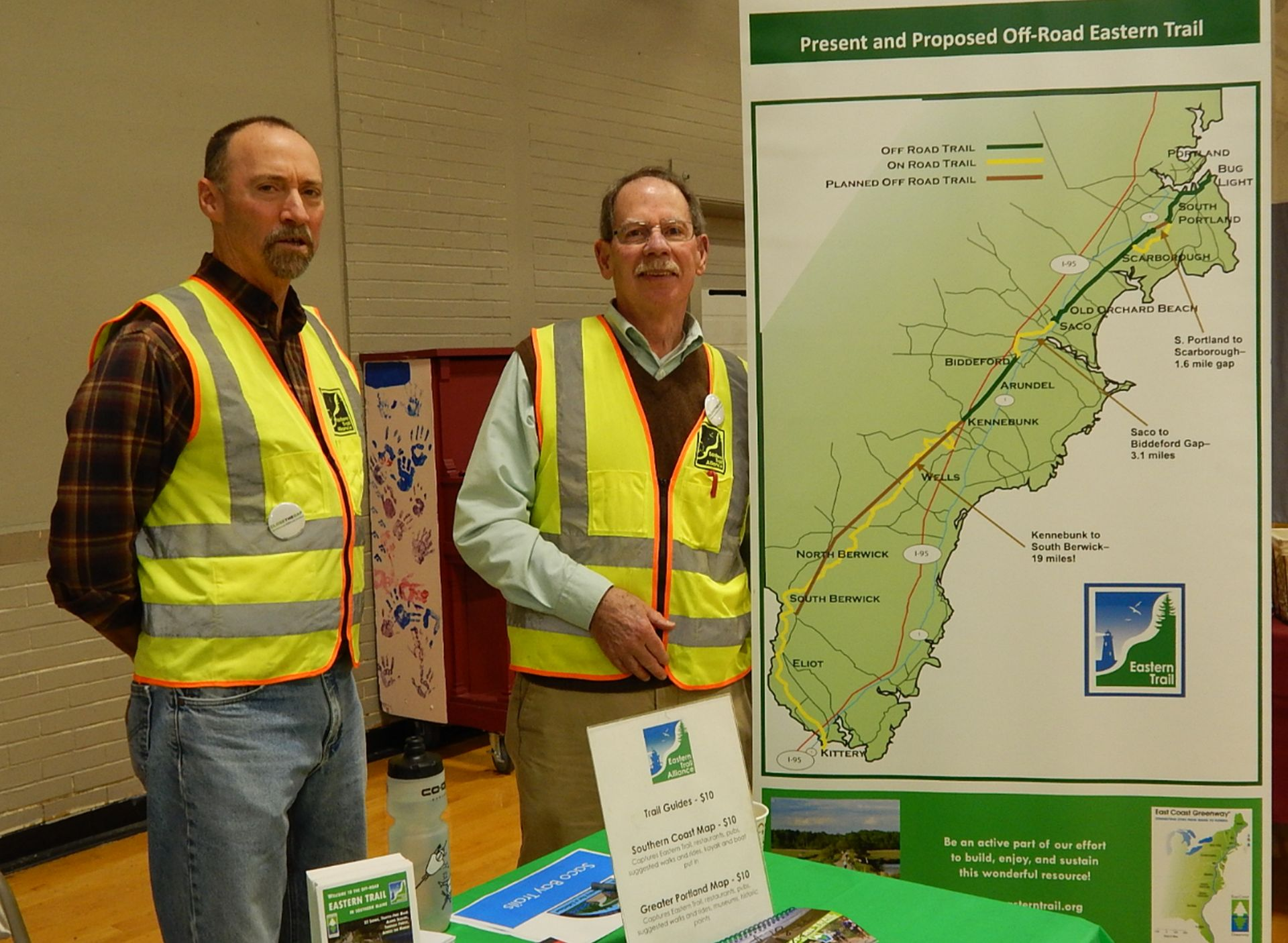 Bob Hamblen, left and Jim Bucar of the Eastern Trail Alliance share information about their organization during the Age Friendly Saco Volunteer Forum and Wellness Fair at the Saco Community Center on Saturday. ED PIERCE/Journal Tribune