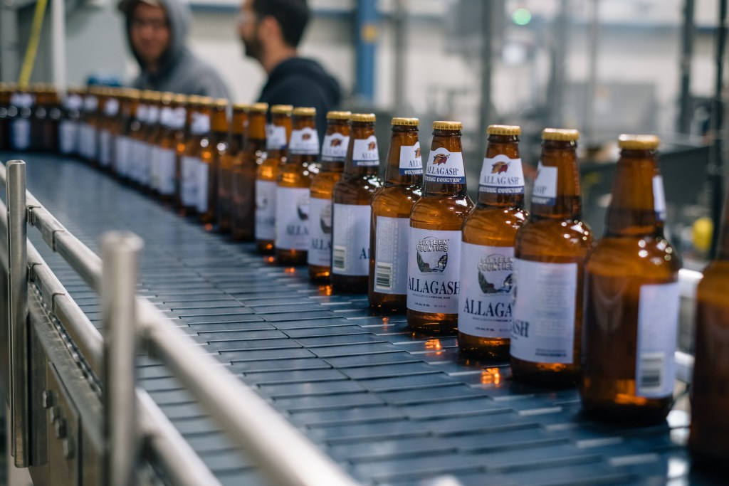 Bottles of Sixteen Counties roll down the line at Allagash.  Photo courtesy of Allagash