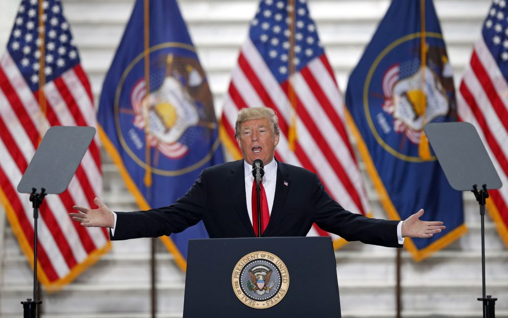 President Trump speaks at the Utah State Capitol Monday after traveling to Salt Lake City to announce plans to shrink two sprawling national monuments in Utah in a move that will delight the state's Republican politicians and many rural residents who see the lands as prime examples of federal overreach, but will enrage tribes and environmentalist groups who vow to immediately sue to preserve the monuments.