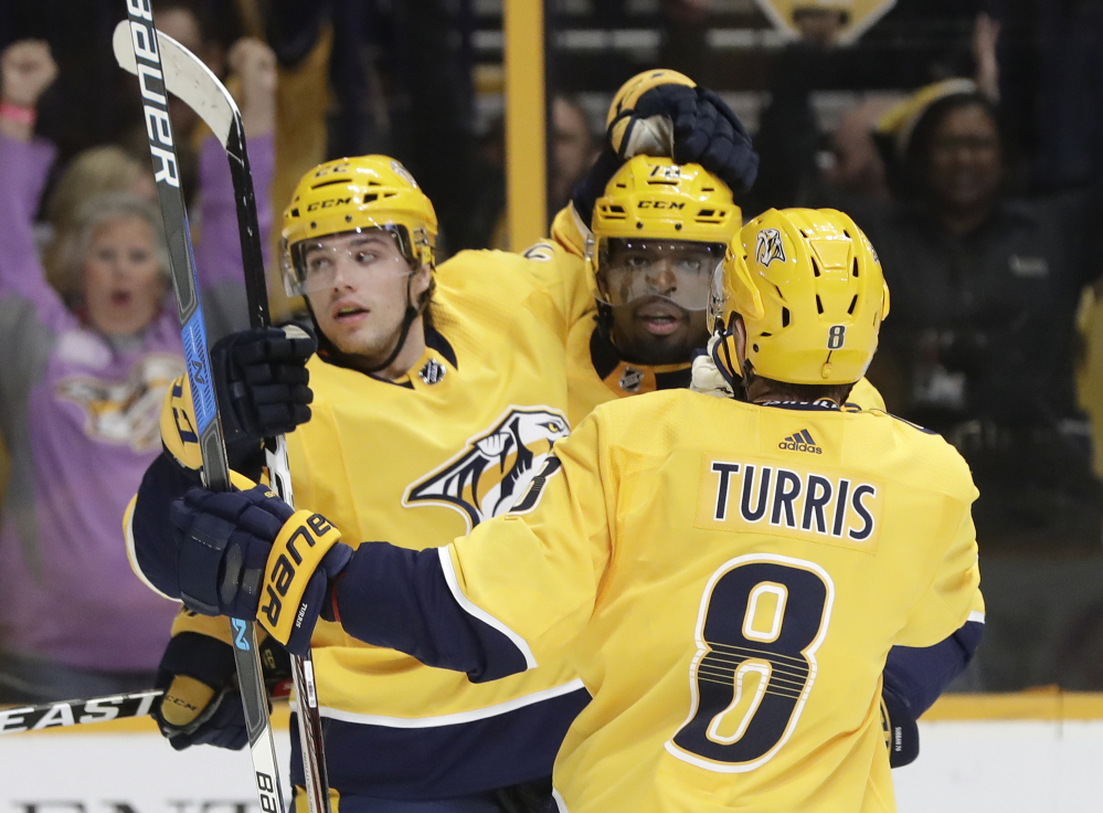 Nashville left wing Kevin Fiala (22) celebrates with P.K. Subban (76) and Kyle Turris after Fiala's goal in the second period. The Predators went on to win, 5-3.