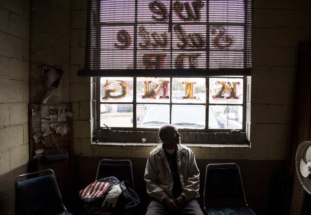 """Pete McElroy, shown at his auto repair shop in Jackson, Miss., says that under President Trump, """"We're losing a lot. ... . He's making the rich richer and the poor poorer."""""""