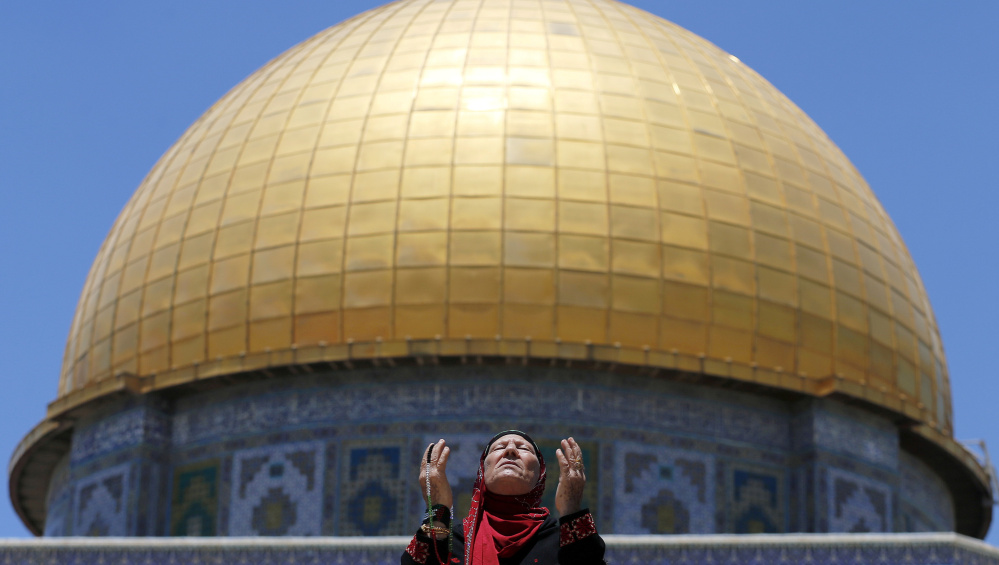 In Jerusalem, a Palestinian prays in front of the Dome of the Rock during Ramadan at the compound known to Muslims as the Noble Sanctuary and to Jews as Temple Mount.