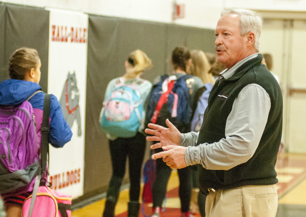 Hall-Dale athletic director Colin Roy greets the visiting Cony Middle School girls' teams and directs them to locker rooms before a game against the Hall-Dale Middle School Bulldogs on Tuesday at Hall-Dale High School in Farmingdale.