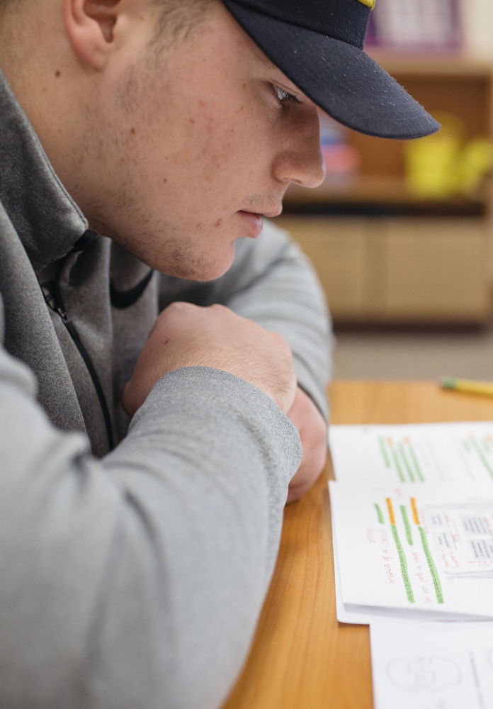 Scarborough high school senior Owen Garrard studies AP psychology during his academic enrichment and support time in teacher Sarah Blaisdell's classroom. Garrard has a weighted GPA of 96 and takes several honors and AP classes.