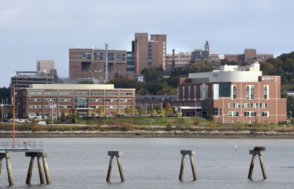 Mercy Hospital plans to relocate and open a new facility in 2021 at its Fore River Parkway campus in Portland, shown in foreground. The site now houses its urgent care center and medical offices.