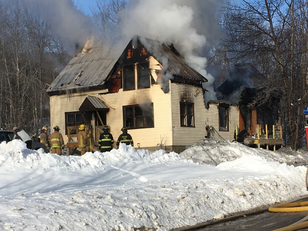 Fire destroyed a house at 107 Swift River Road in Mexico on Saturday morning. All occupants got out safely.