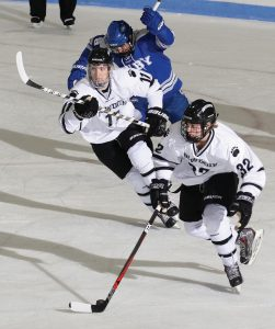 BOWDOIN COLLEGE'S Jack Bliss (32) carries the puck up the ice while teammate Pat Geary (11) follows during a NESCAC men's hockey game Saturday night at Watson Arena.