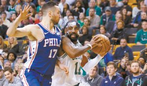 BOSTON CELTICS Kyrie Irving drives on Philadelphia 76ers' JJ Redick during the fourth quarter of Boston's 108-97 win in an NBA basketball game in Boston on Thursday. Irving paced the Celtics with 36 points.