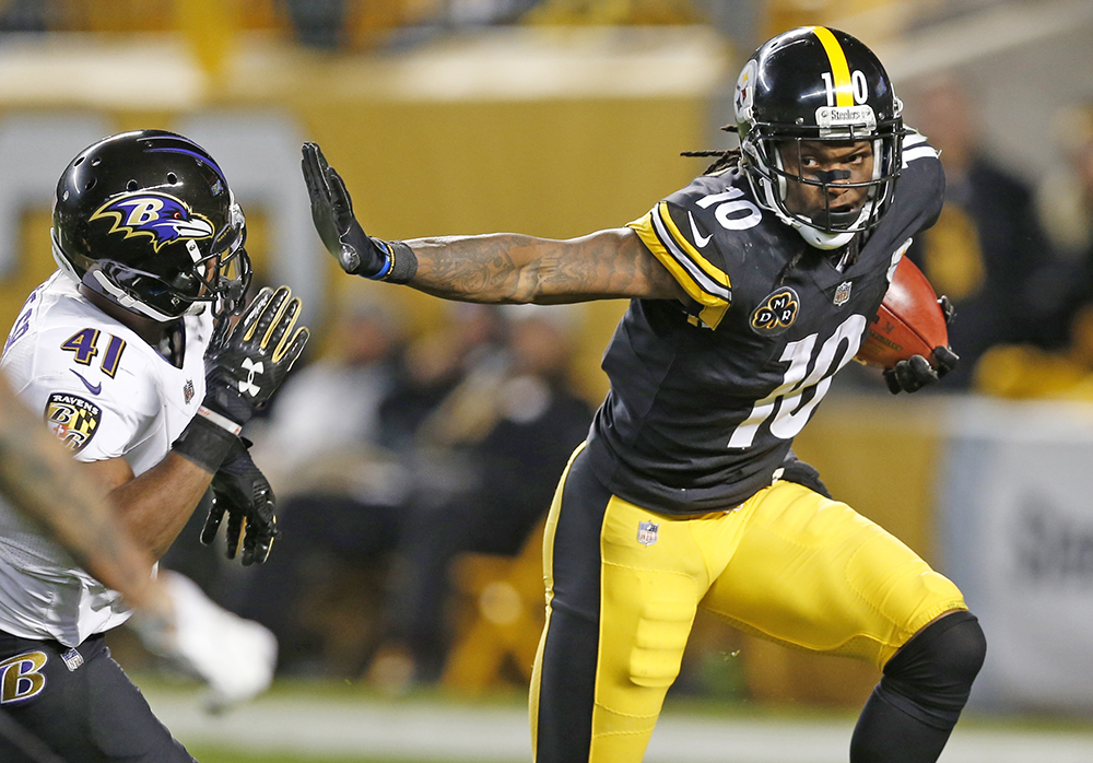 Steelers wide receiver Martavis Bryant stiff-arms Ravens cornerback Anthony Levine during the second half Sunday in Pittsburgh.