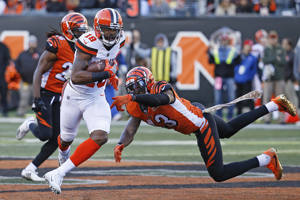 Browns receiver Kenny Britt shakes off Cincinnati Bengals free safety George Iloka on Nov. 26.