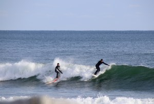 And they're upright! Christmas Eve day  was a beautiful day to watch the surfers at Fortune's Rocks TAMMY WELLS/Journal Tribune