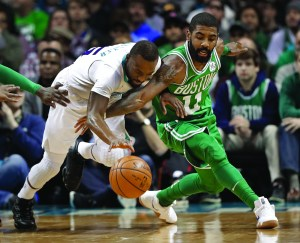 Charlotte Hornets' Kemba Walker, left, and Boston Celtics' Kyrie Irving, right, battle for the ball during the first half of an NBA basketball game in Charlotte, N.C., Wednesday, Dec. 27, 2017. AP NEWSWIRE