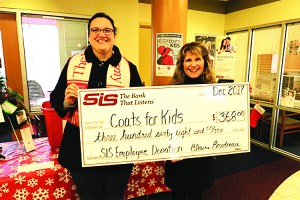 "Linda Nadeau, right, SIS Bank's Assistant to Senior Management, presents Erin Smullen of the Sanford Salvation Army with a check for $368 raised from Bank employees during the recent ""Casual for a Cause"" day. The money will go toward the purchase of winter coats, hats and mittens to accompany those collected during the Coats for Kids drive. SUBMITTED PHOTO"