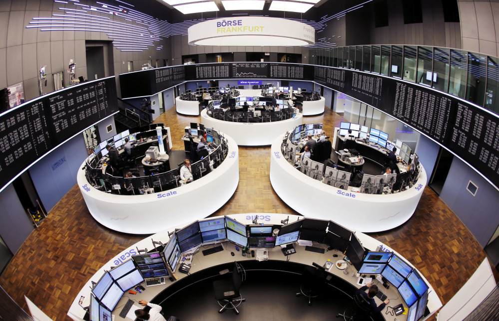 The trading room at the German stock market in Frankfurt, Germany. New regulations pushing more trading onto public exchanges went into effect Wednesday in Europe.