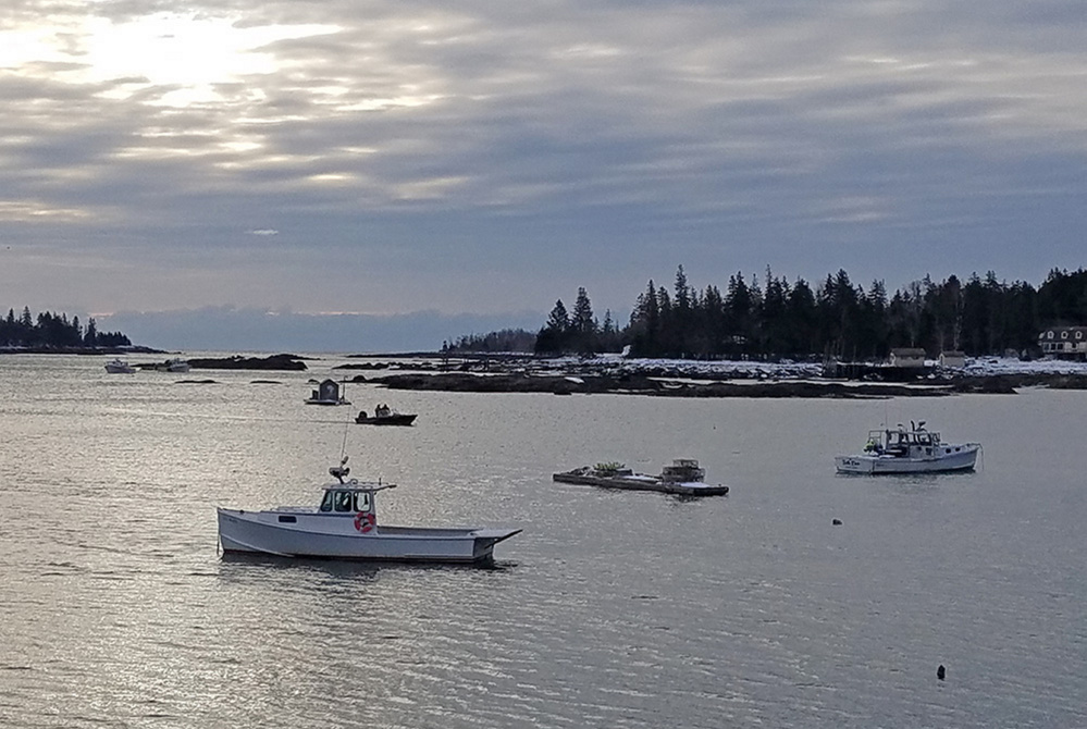 Paul Benner of Thomaston left to go clamming from the former Great Eastern Mussel Farm dock off Long Cove Road in St. George. Photo was taken Friday from the dock.