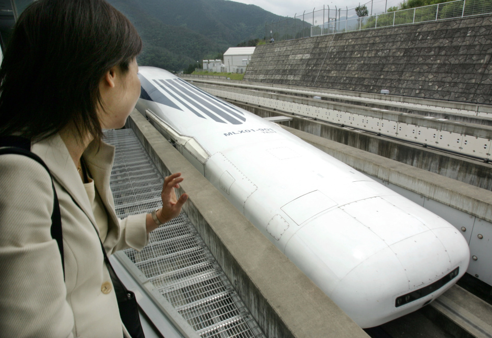 Central Japan Railway Co.'s Maglev train makes a test run west of Tokyo in 2004. Maglev technology uses magnetic forces to lift and propel trains at speeds up to 375 mph.
