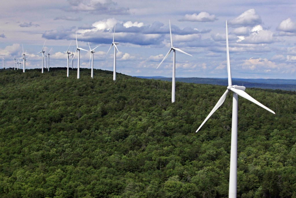 "Wind turbines line a ridge in Township 8, Range 3 in Maine. Critics of the governor's newly imposed wind-power moratorium said it ""would be unable to withstand legal scrutiny,"" while others called it ""great news for the thousands ... who are opposed to wind development"" as a threat to tourism."