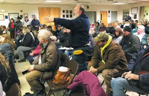 BAY BRIDGE ESTATES RESIDENTS direct questions to Brunswick town officials who attended a meeting Friday to talk about water problems at the mobile home park.