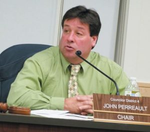 COUNCIL CHAIRMAN JOHN PERREAULT conducts business at Tuesday night's meeting in Brunswick.