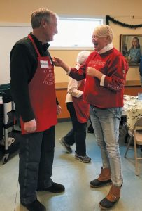U.S. SEN. ANGUS KING OF BRUNSWICK speaks with Katherine Heuer, a member of the homeless community, while volunteering at Mid Coast Hunger Prevention Program's soup kitchen on Monday in celebration of Martin Luther King Jr. Day.