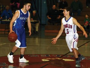 MORSE'S PARKER ONORATO, left, brings the ball up the court with Mt. Ararat's Max Spelke (5) guarding him during a KVAC clash at Topsham on Tuesday. The host Eagles rolled to an 85-65 win.