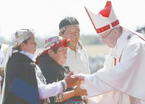 POPE FRANCIS greets Mapuches in an offertory of a Mass at the Maquehue Air Base, in Temuco, Chile, Wednesday, Jan. 17.
