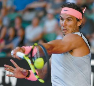 SPAIN'S RAFAEL NADAL makes a forehand return to Argentina's Leonardo Mayer during their second round match at the Australian Open tennis championships in Melbourne, Australia on Wednesday.