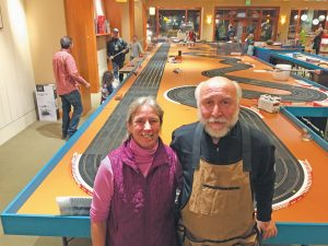 FASCINATION STATION & SLOT CAR JUNCTION CO-OWNERS Cathy Piffath and Jeff Cooper at their store's grand reopening in early December.