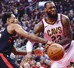 CLEVELAND CAVALIERS forward LeBron James (23) reacts after being fouled by Toronto Raptors guard DeMar DeRozan (10) during the second half of an NBA basketball game on Thursday in Toronto. The Raptors rolled to a 133-99 victory.