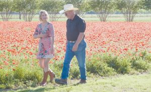 "TV TRAVEL show host Samantha Brown walks through a field of flowers in Fredericksburg, Texas, in this April 4, 2017, with John Thomas, the owner of Wildseed Farms. Brown has a new series premiering Jan. 6 on PBS called ""Places to Love."""