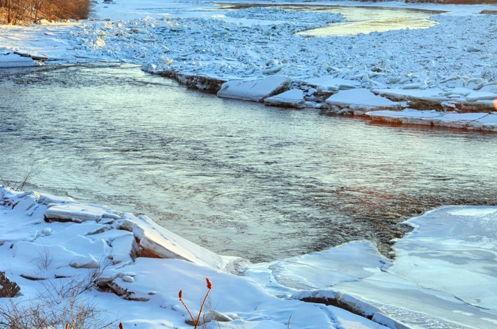 The Kennebec River is seen late Thursday afternoon flowing past an ice jam between Randolph and Farmingdale.