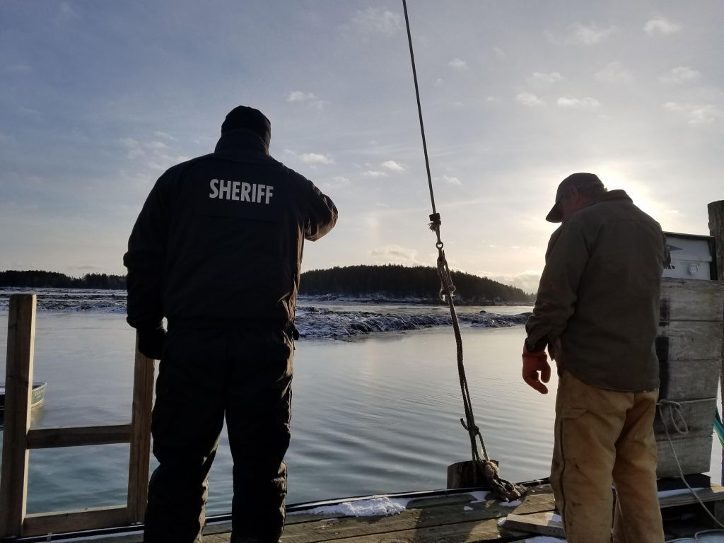 Knox County Sheriff's Office Chief Deputy Tim Carroll, left, looks out over the cove where search efforts continued Saturday for Paul Benner. His body was recovered Monday.