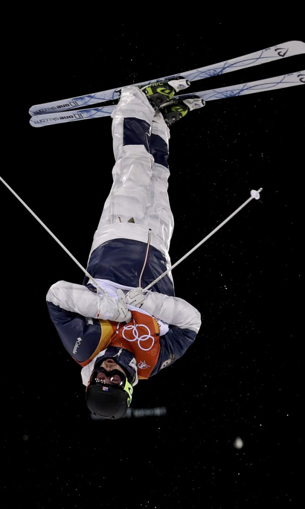 Troy Murphy, of the United States, jumps during the first round of men's moguls finals Monday at Phoenix Snow Park at the 2018 Winter Olympics in PyeongChang, South Korea. Murphy, of Bethel, scored 72.72 and did not advance to the second round. Story, D5