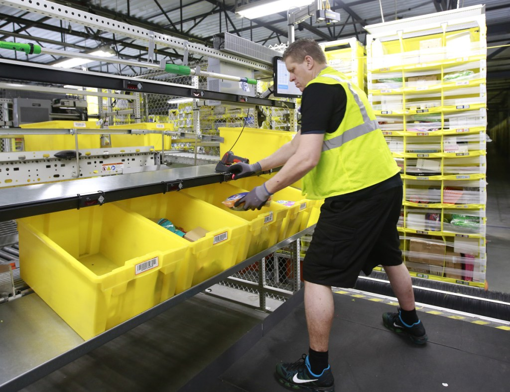 Merchandise is scanned to be tracked as it moves through the new Amazon Fulfillment Center Friday, Feb. 9, 2018, in Sacramento, Calif. The center opened in October 2017. (AP Photo/Rich Pedroncelli)