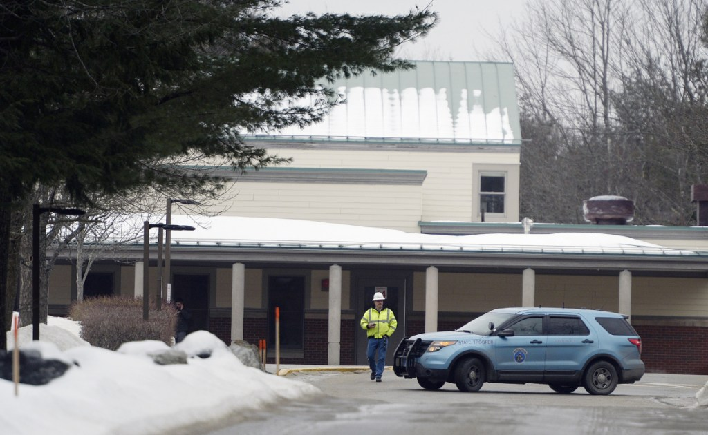 A Maine State Police cruiser is parked outside Woodside Elementary School in Topsham following a threat Friday. Authorities later declared the school secure.