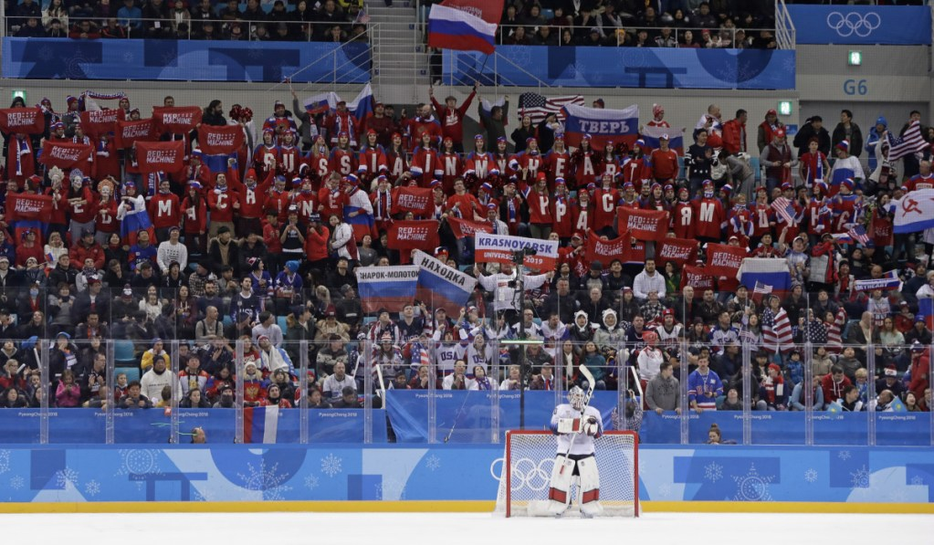 Supporters of Russian athletes cheer as goalie Ryan Zapolski of the United States waits during the first period at the 2018 Winter Olympics in Gangneung, South Korea on Saturday. The team from Russia won, 4-0.