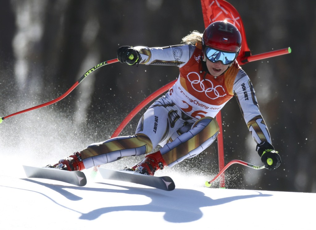 Ester Ledecka kept waiting for her time to change after finishing her final run in the super-G at the Winter Olympics on Saturday. It never did and Ledecka, a snowboarder by trade, won skiing gold.