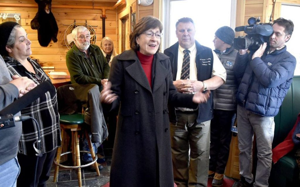 U.S. Sen. Susan Collins, R-Maine, visits with townspeople at Schmoose's Bar and Grill in Jackman on Thursday.
