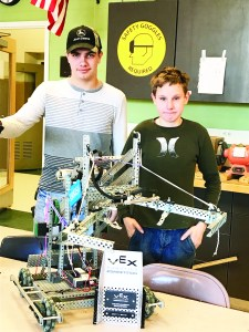 Thornton Academy students Brandon Delisle, left, and Carl Meserve display the winning robot they have built and designed. COURTESY PHOTO/Katy Nicketakis