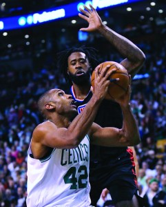 Los Angeles Clippers center DeAndre Jordan, rear, prepares to block a shot by Boston Celtics forward Al Horford (42) during the second quarter of an NBA basketball game in Boston, Wednesday. AP NEWSWIRE