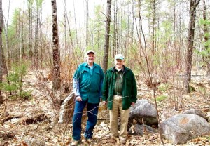 Kevin McKeon and Mousam Way Land Trust President Gordon Johnston stand in a clearing on the Blanchard Project property in Springvale, which the land trust plans to acquire, in this 2016 file photo. The land trust has created a survey, asking people what  they think should be the focus of the land trust's efforts. TAMMY WELLS/Journal Tribune file photo