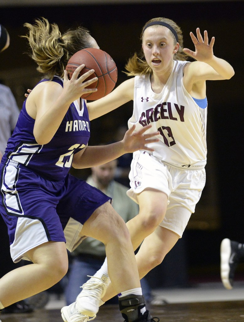 PORTLAND, ME - MARCH 1: Greely's Brooke Obar plays defense on Hampden Academy's Braylee Wildman Thursday, March 1, 2018. (Staff photo by Shawn Patrick Ouellette/Staff Photographer)