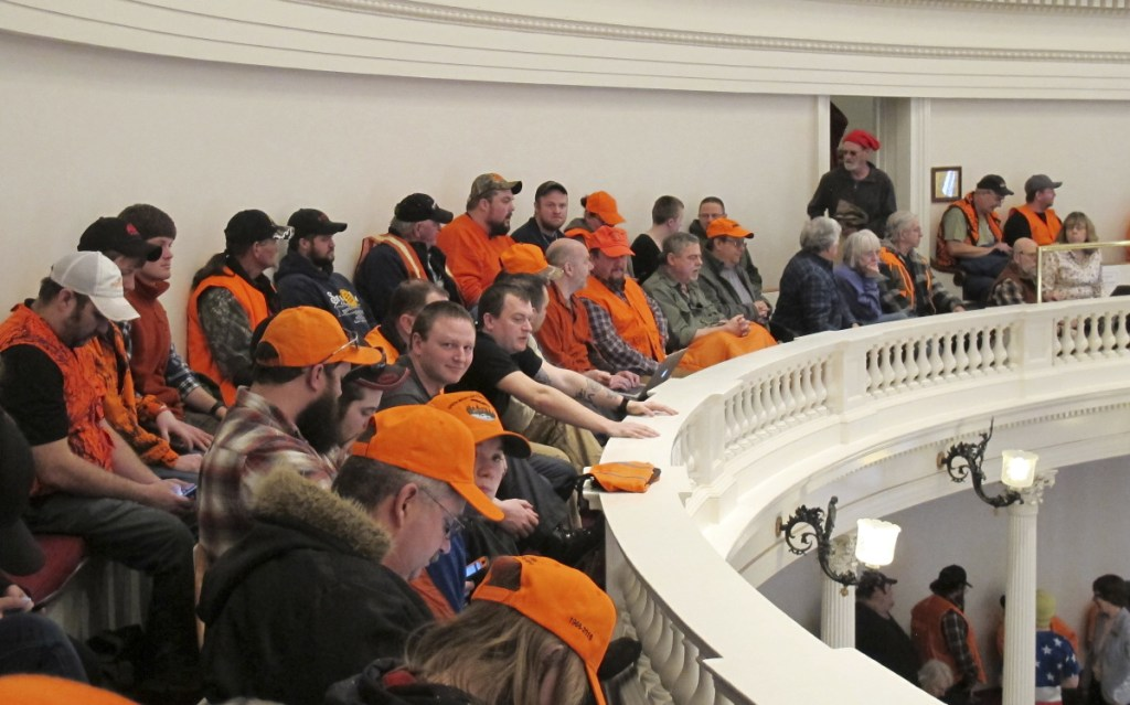 Gun control opponents wearing hunter orange pack the gallery in the Vermont House of Representatives on March 27 in Montpelier, Vt.
